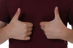 Child is winner and has success, showing thumbs up Royalty Free Stock Photo