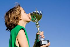 Child winner of trophy or cup Royalty Free Stock Photography