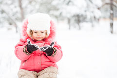 Child in winter. Portrait of funny child in winter against snow background Stock Photos