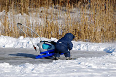 A child in winter. A child is playing on ice in winter Stock Photo