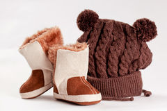 Child Winter Boots And Cap Stock Photos