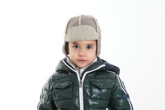 Child in winter clothes. On white background Royalty Free Stock Images