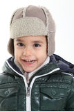 Child in winter clothes. On white background Stock Image