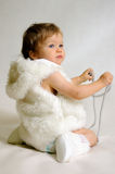 Child in winter clothes. With jewelry Royalty Free Stock Photo