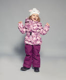 Child in winter clothes Royalty Free Stock Images