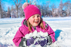 Child in winter clothes stock photo