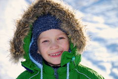 Child in winter coat smiling Stock Photo