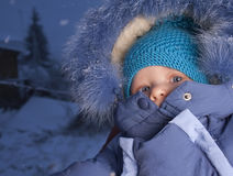 Child in winter evening Stock Images