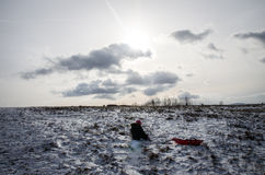 Child on winter field Royalty Free Stock Photos