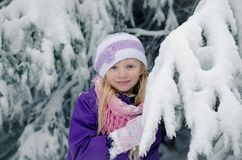 Child in winter forest having fun stock images