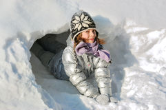 Child winter fun with snow Stock Images