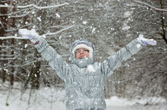 Child winter fun in snowy forest Stock Photography