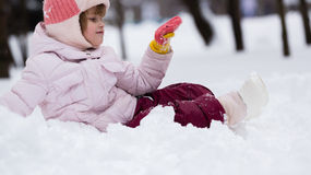 Child in winter. Girl rolling down the hills. Child in winter. Girl rolling down stock photography
