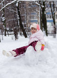 Child in winter. Girl rolling down the hills. Child in winter. Girl rolling down royalty free stock photos
