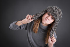 Child with winter hat making faces Stock Photo