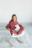 Child in winter pajamas Stock Images