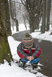 Child in winter park stock images