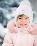 Child in winter park Royalty Free Stock Photo