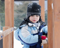 Child in winter playground Royalty Free Stock Image