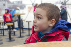 Child in winter resort skiing bar Stock Image