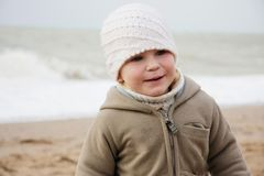 Child on winter sea background Royalty Free Stock Photo