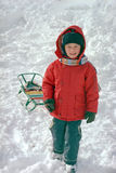 Child on winter snow Royalty Free Stock Image