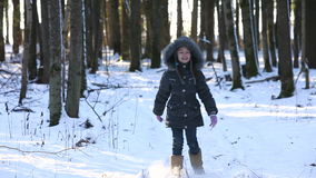 The child is in the winter woods. stock footage