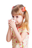 Child wiping or cleaning nose with tissue isolated on white Stock Photos