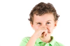 Child wiping his nose. Close-up portrait of a child wiping his nose Royalty Free Stock Photos