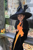 Child witch at Halloween party Stock Images