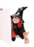 Child  witch holding banner Royalty Free Stock Photography