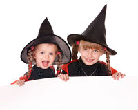 Child  witch holding banner . Royalty Free Stock Photography