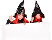 Child  witch holding banner . Royalty Free Stock Images