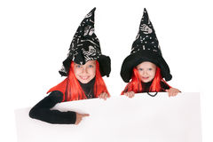 Child  witch holding banner and thumb up. Royalty Free Stock Photos