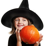 Child - witch with pumpkin Royalty Free Stock Photography