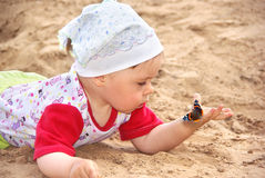 Child With A Butterfly. Royalty Free Stock Images