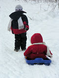 Child With Baby On Sled Royalty Free Stock Photos