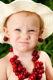 Child With Cherry Beads Stock Photo
