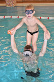 Child With Father In Pool Stock Photo