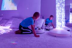 Free Child With Intellectual Disability In Sensory Stimulating Room, Snoezelen. Autistic Child Interacting During Therapy Session. Stock Photography - 200794332