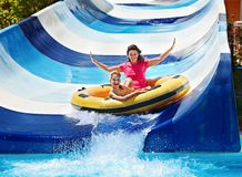 Free Child With Mother On Water Slide At Aquapark. Royalty Free Stock Photography - 30021357