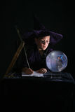 Child wizard writing a spell Royalty Free Stock Photography