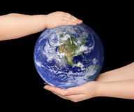 Child and woman holds earth globe Royalty Free Stock Photo