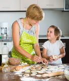 Child with woman making meat dumplings Stock Photography