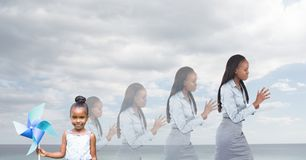 child and Women of age generations growing up with sea sky Stock Photography
