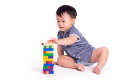 Child with wood block Royalty Free Stock Images