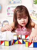 Child with wood block in play room. Royalty Free Stock Image
