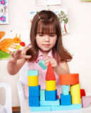 Child with wood block  in play room. Royalty Free Stock Photography