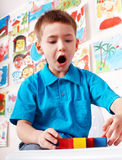Child with wood block  in play room. Royalty Free Stock Photo