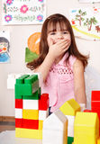 Child with wood block in play room. Stock Image